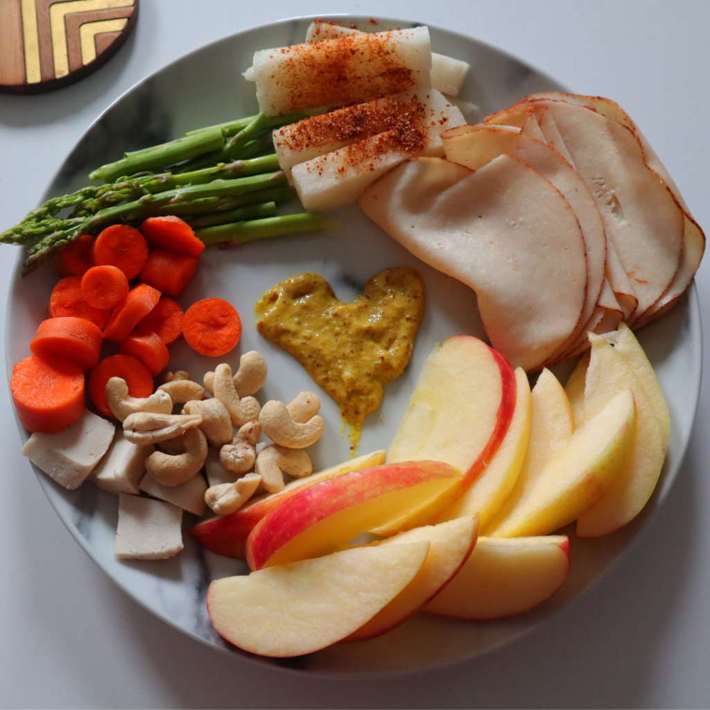 what I eat in day low carb snack plate. Apples, cashews, veggies, turkey.