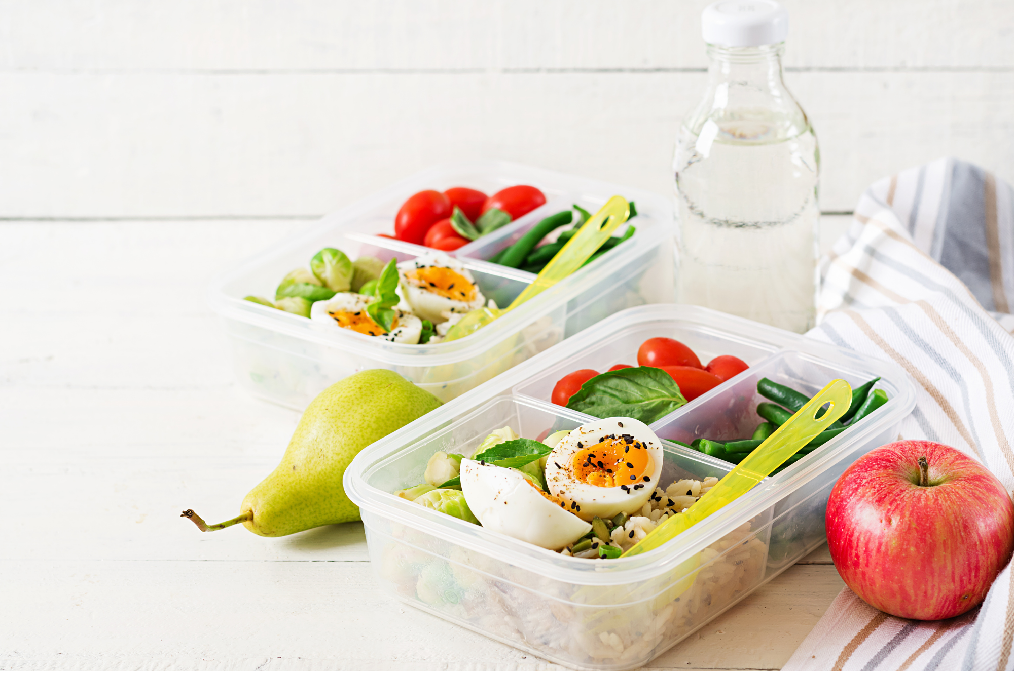 weight loss meal prep ideas. two containers of eggs, veggies and fruit on the side.