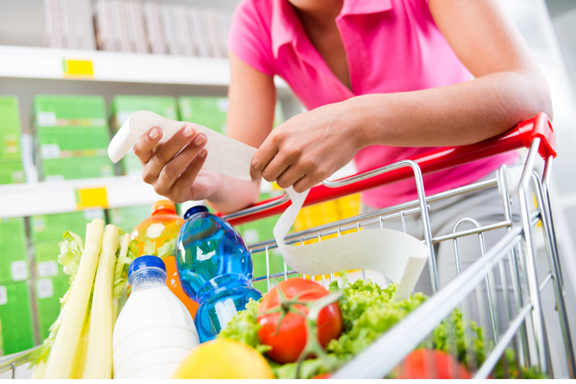 low carb on a budget women looking at grocery list in store