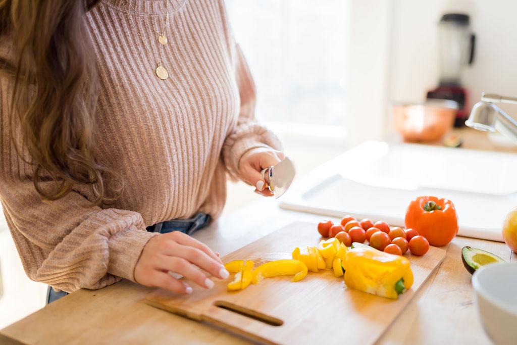 women cutting vegetables